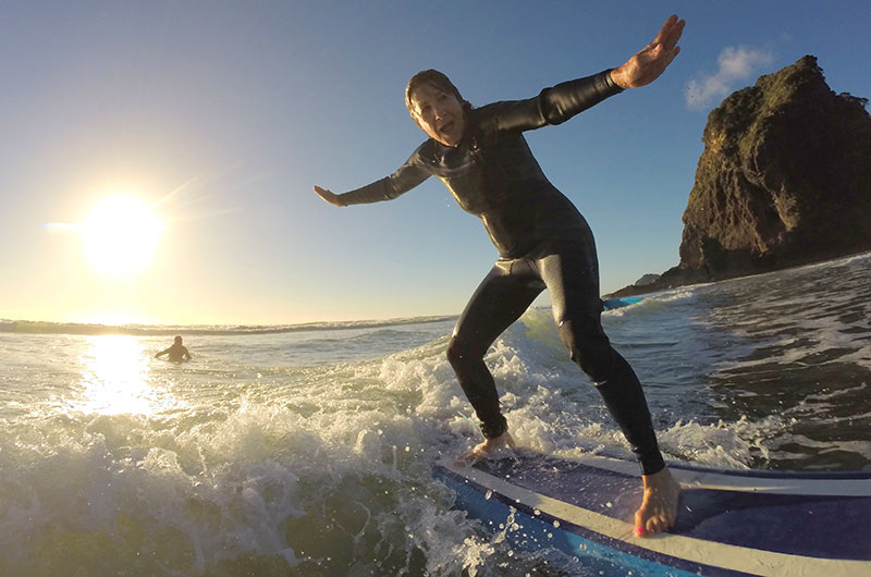Surfing at Piha Beach Auckland